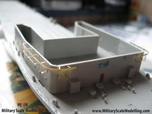 048 working on the lower front deck JPG USS ESSEX CV9 In Progress Pictures