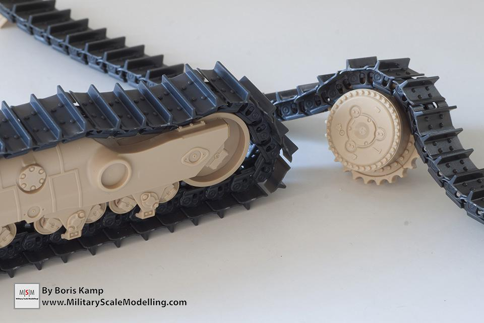 The tracks on the running gear and drive sprocket (1:35 D9R Bulldozer Meng SS-002)