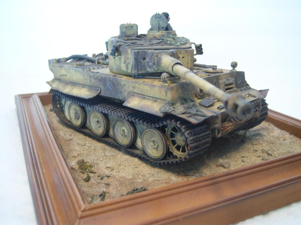 """These are a Tiger1 and an M4E8 Sherman I built for a """"Fury"""" diorama All brush work. Just"""