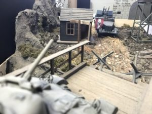This is all scratch built except the vehicles. The guard shack has a full interior with a map of Eur